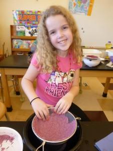 WES student enjoys paper mache!